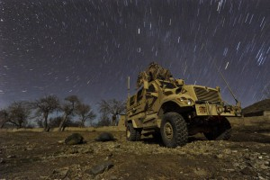 U.S. Army Pfc. Brent Dawkins, left, and U.S. Air Force Tech. Sgt. Efren Lopez sleep on the ground outside a mine-resistant, ambush-protected vehicle during a cold winter night in Wam Valley, Kandahar province, Afghanistan, Dec. 22, 2009. (U.S. Air Force photo by Tech. Sgt. Efren Lopez)