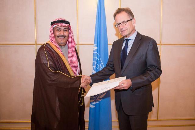 Mr. Faisal bin Hassan Trad (left) Mr. Michael Møller (right)