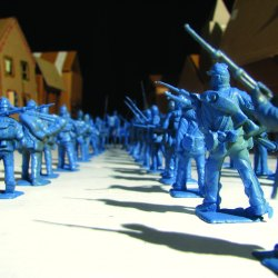 blue toy soldiers face off against each other with cardboard houses