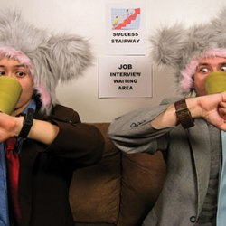 Two people in costume sit in Job Interview Waiting Area