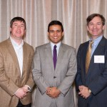 Three men pose together at scholar luncheon