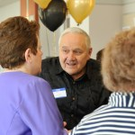 People talking with balloons in background at ANCS Luncheon