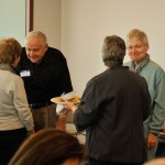 People mingling at ancient studies luncheon