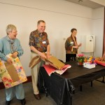 people opening gifts at ancient studies reunion
