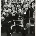 1967 Schamp at podium during graduation