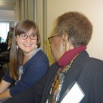 Two women talk at political science reception