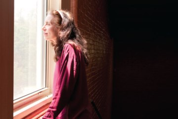 Woman looks out of window