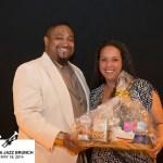 Couple hold gift basket at Jazz brunch