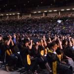 Graduates moving their tassles