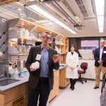 group with goggles take tour through lab