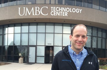 Adelstein poses in front of UMBC technology center