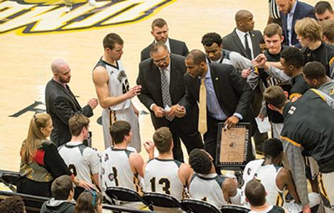 coaches talk to basketball team