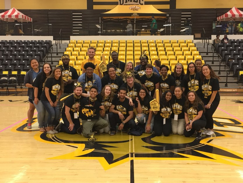 seb students pose with UMBC gear on basketball court