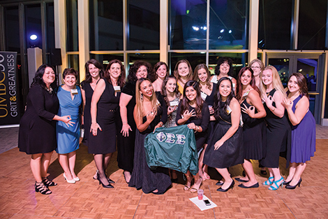 Sorority poses together at Grit and Greekness event