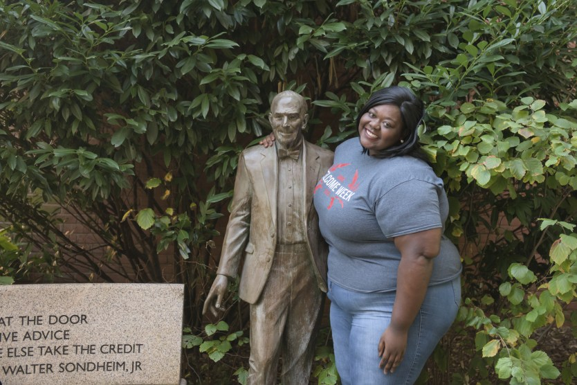 Andrea poses with sondheim statue