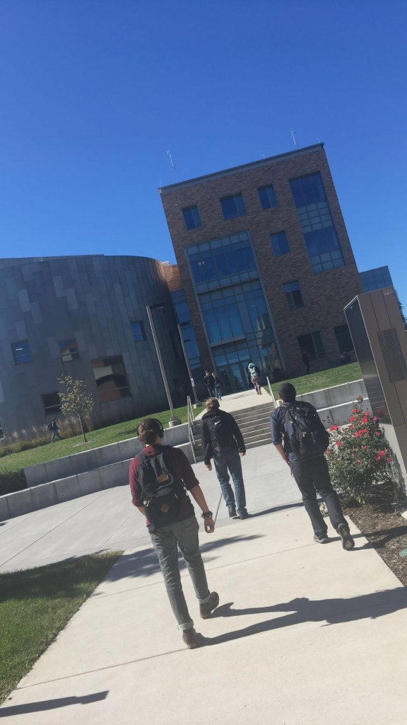students walking towards PAHB