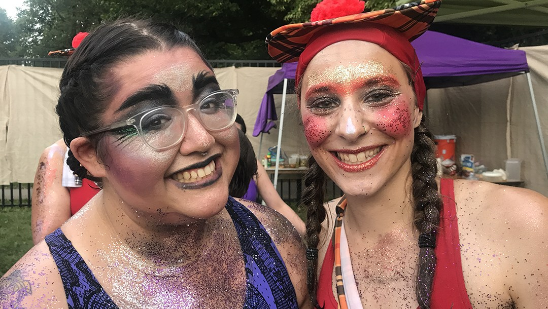 Two people posing with facepaint