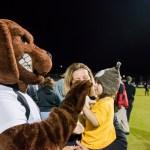 UMBC mascott gives kid a high five at soccer field