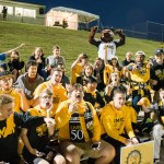 UMBC student fans pose for a picture at soccer park