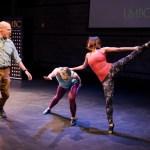 Three dancers perform on stage