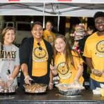 Students serving food at homecoming
