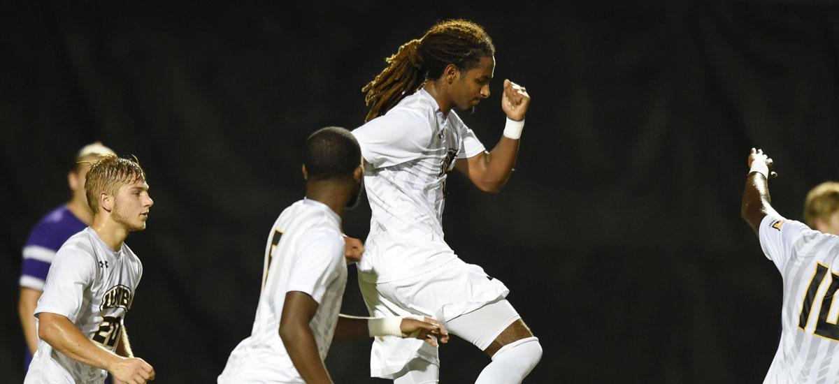 Soccer player celebrates a goal