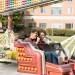 Two girls riding carnival ride