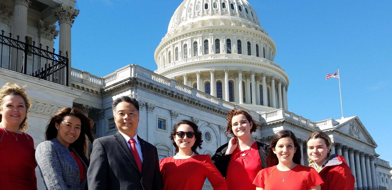 Group pose in front of capitol building