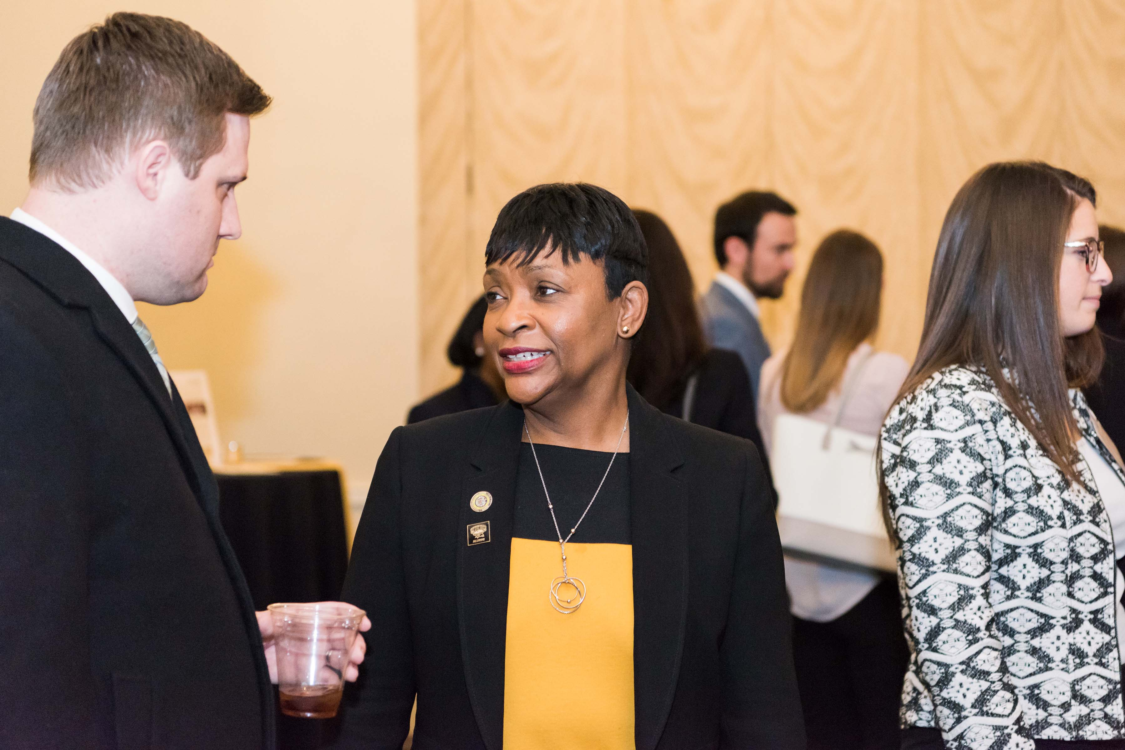 Two people talking at Annapolis Alumni reception