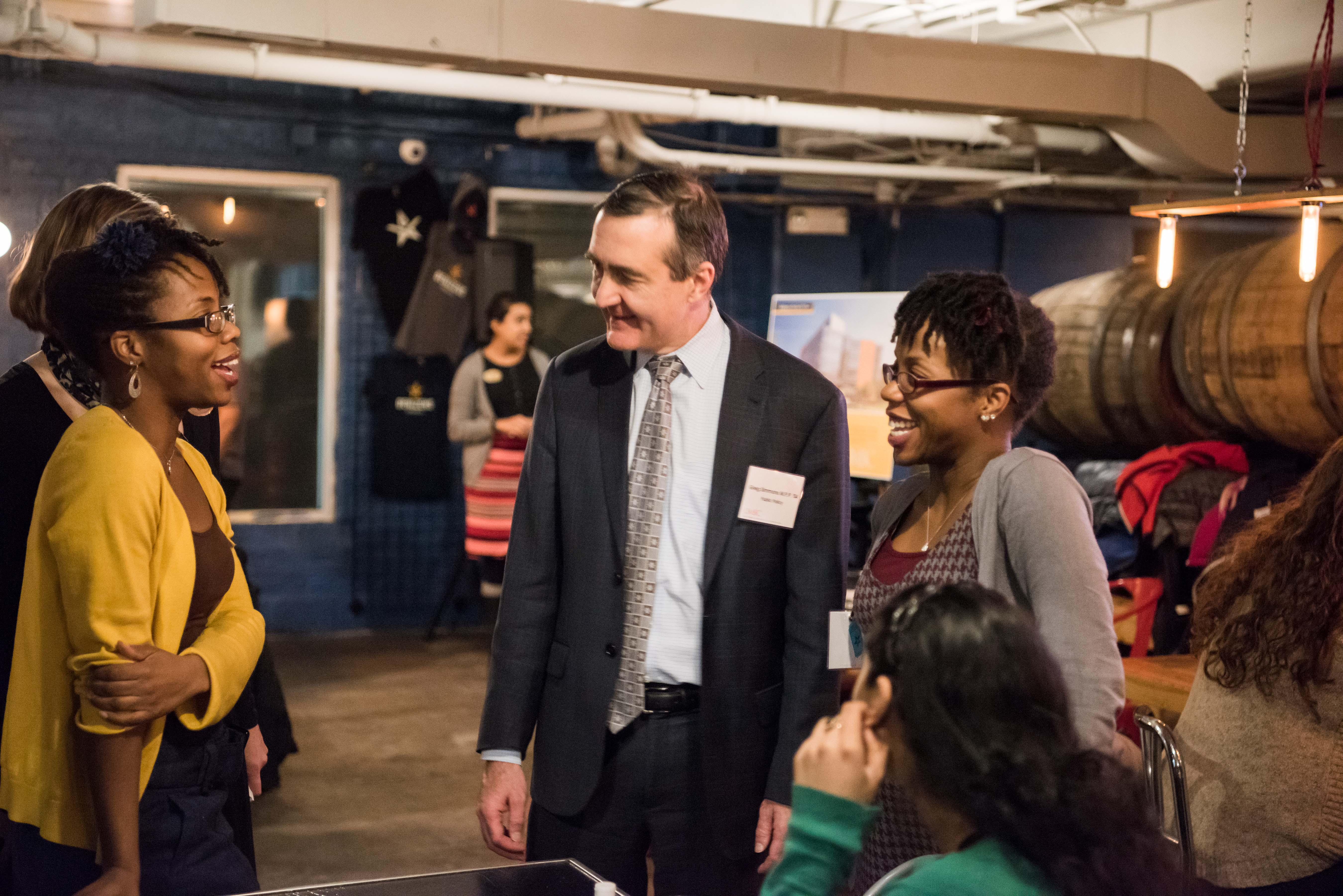 Greg simmons talks to group of women for chocolate city bar talk