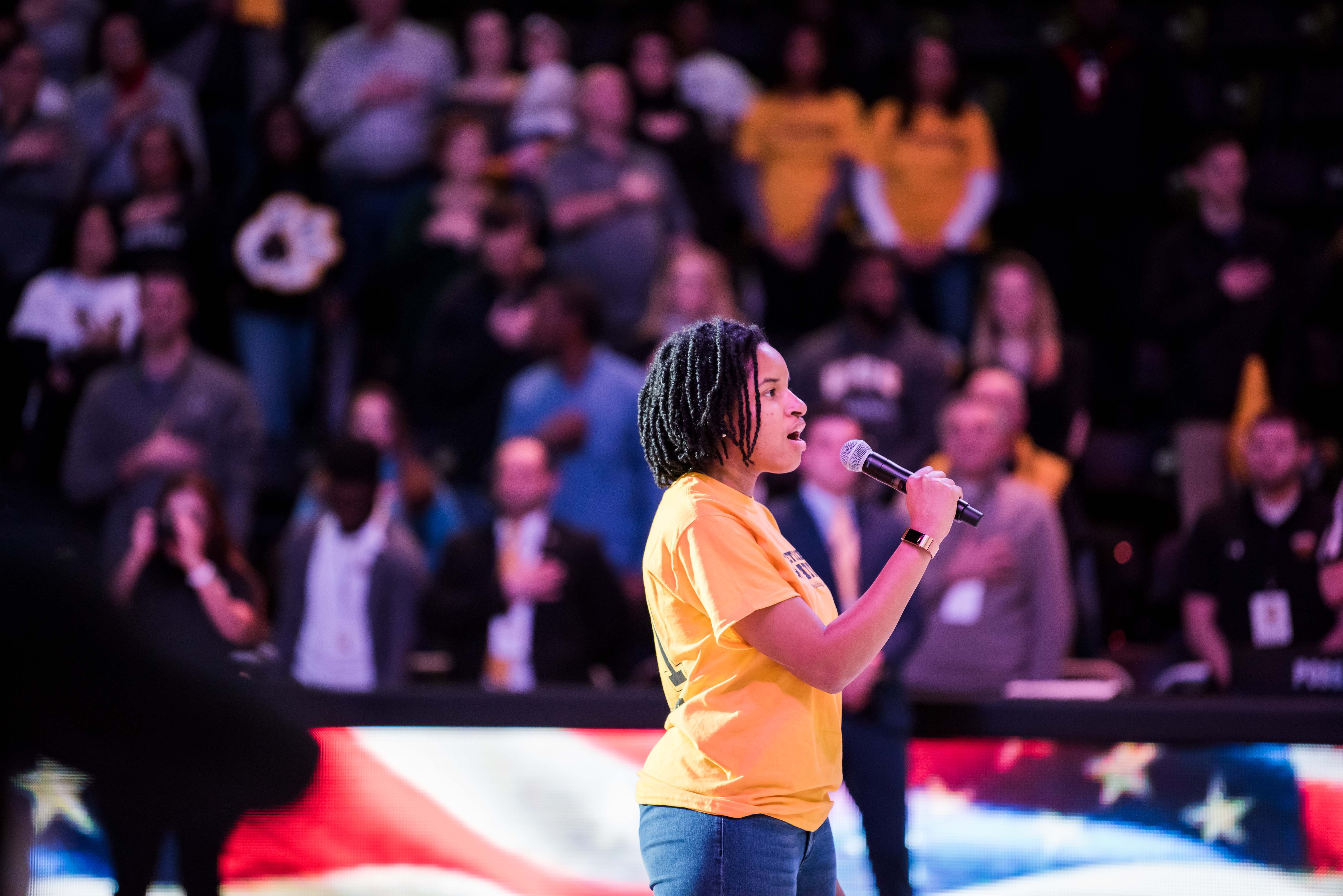 Woman sings for opening of event center