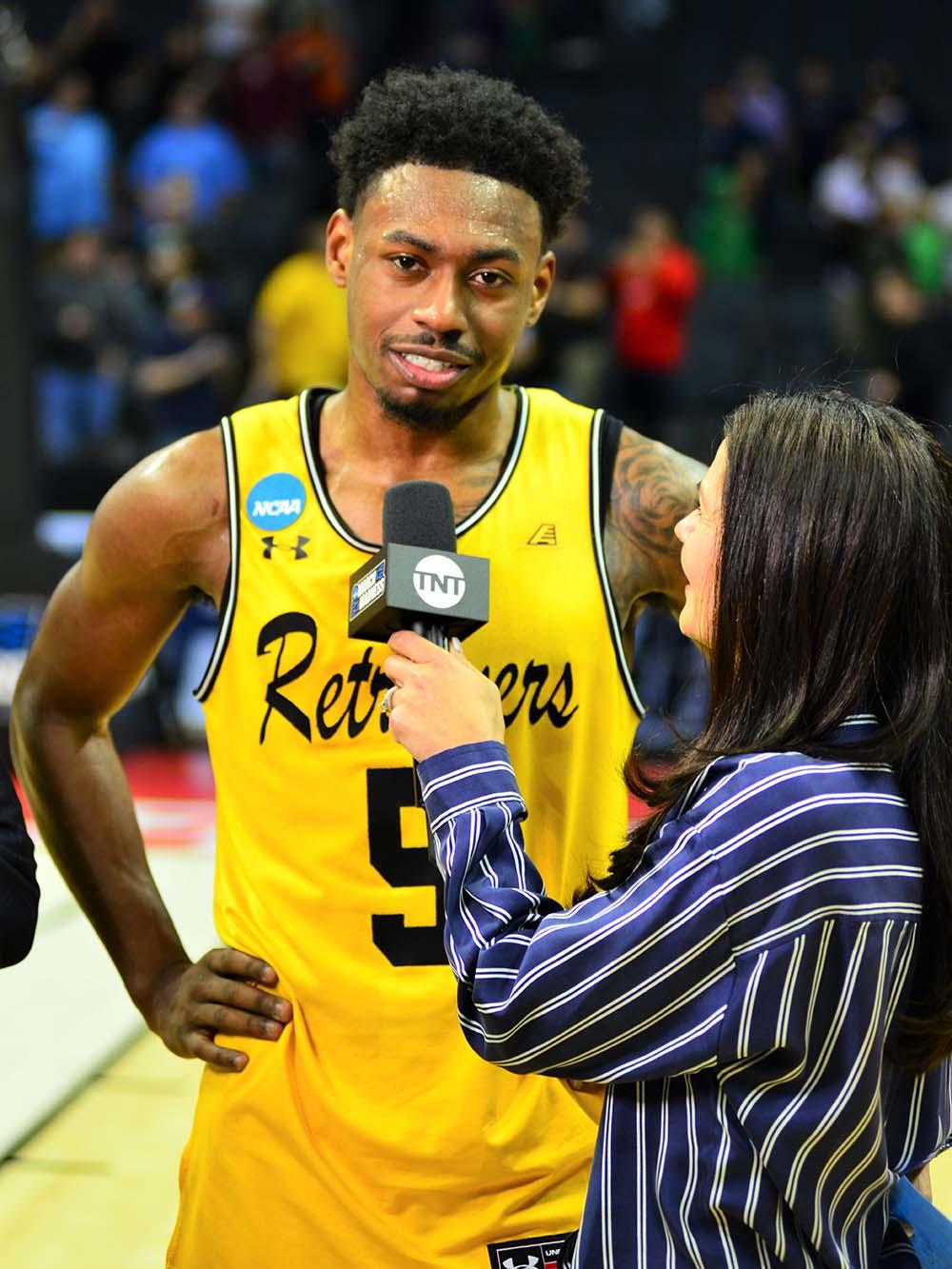 Retrievers basketball player interviewed by TNT