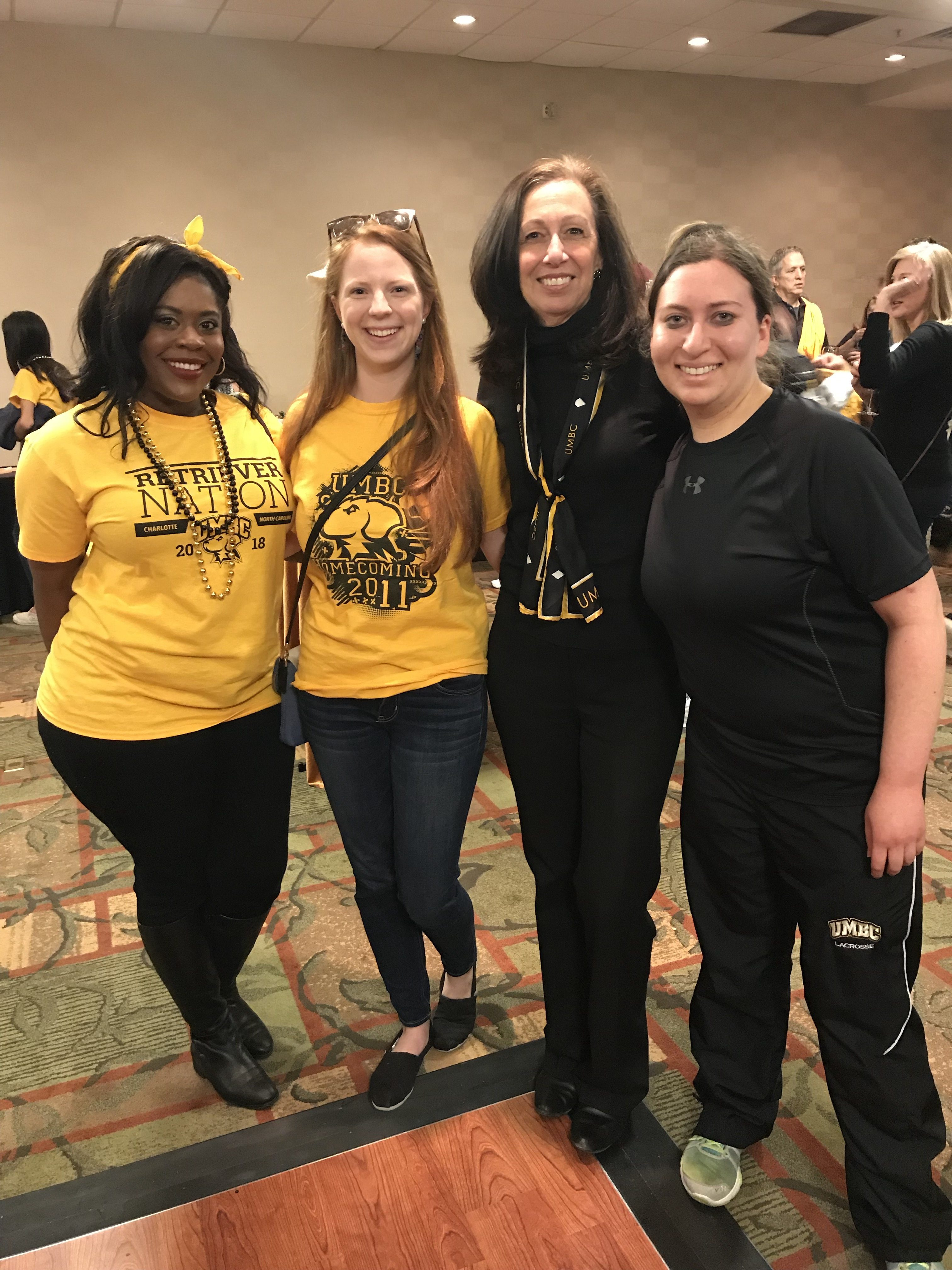 Nancy Young poses with others in UMC gear