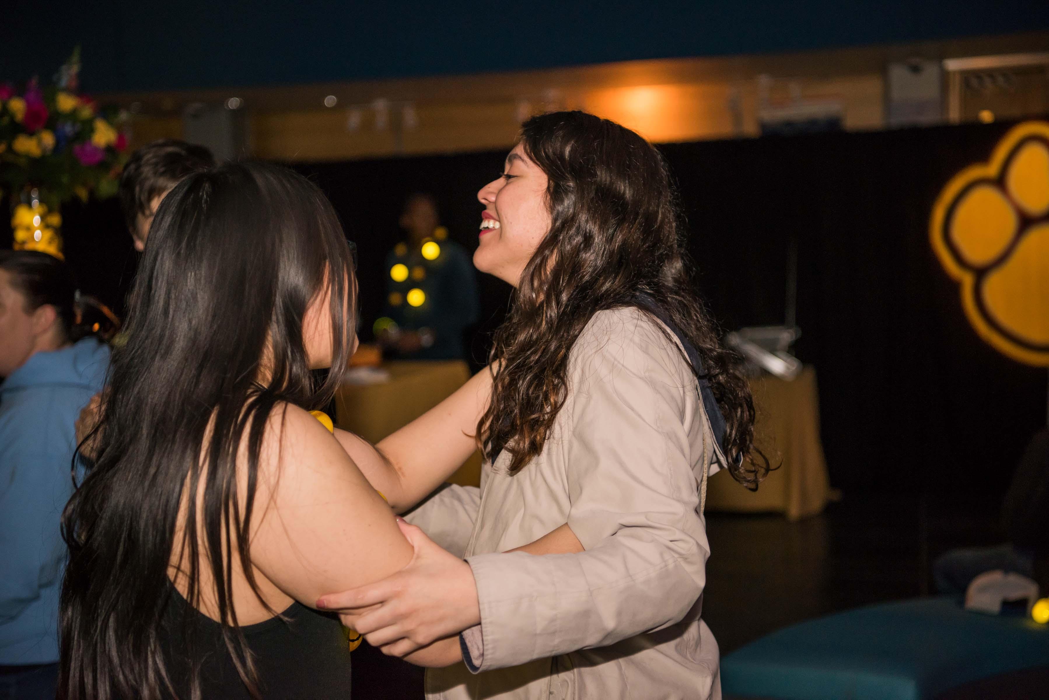 Two girls dancing at alumni reception