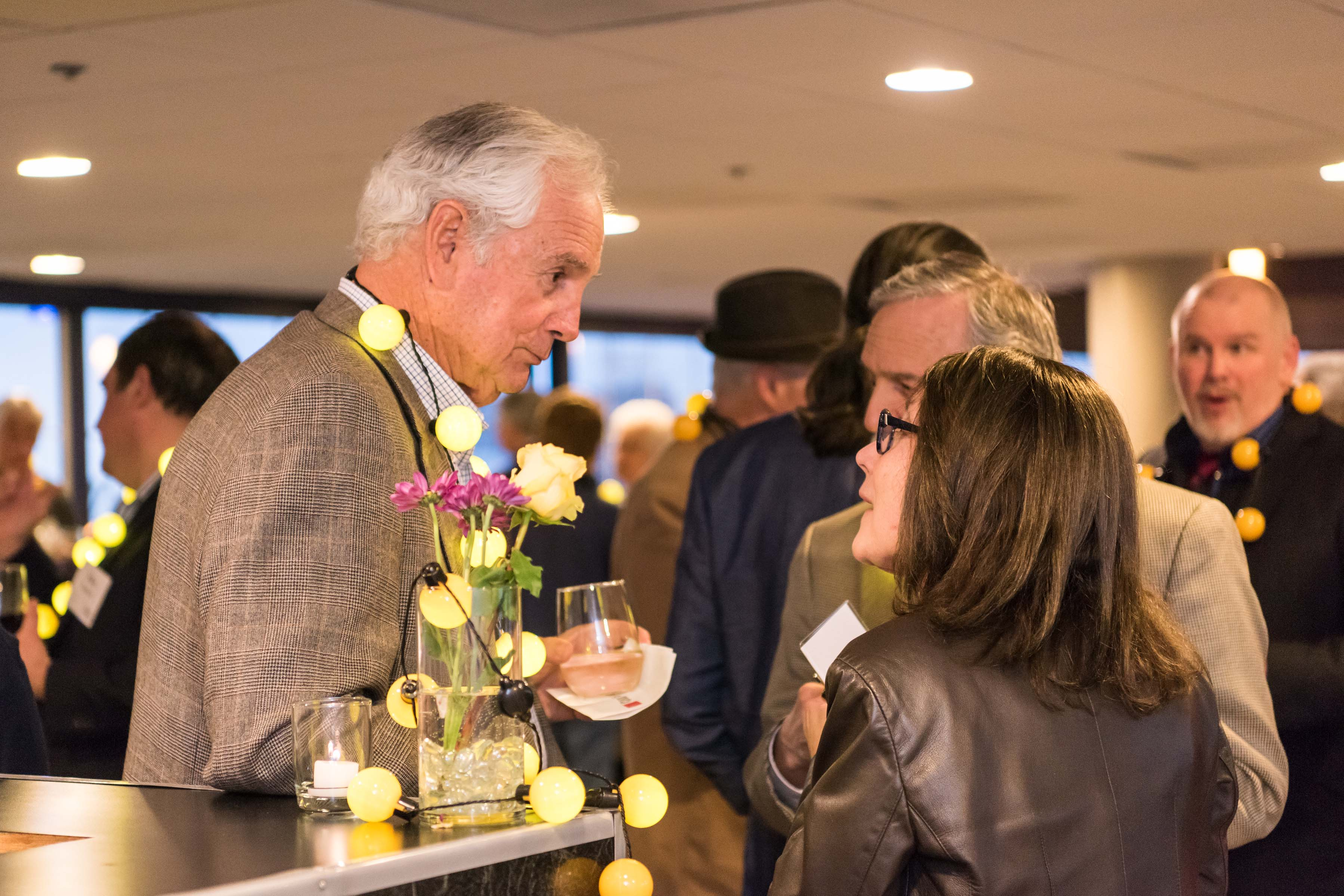 People interacting at Pier5 reception