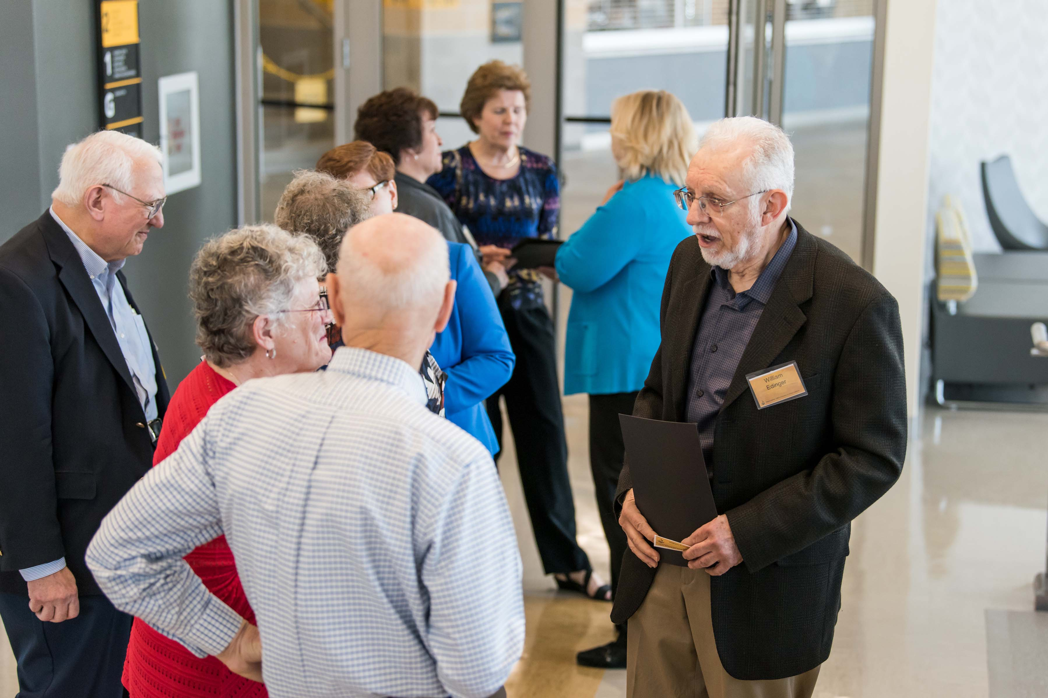 People mingle at Wisdom Institute lunch