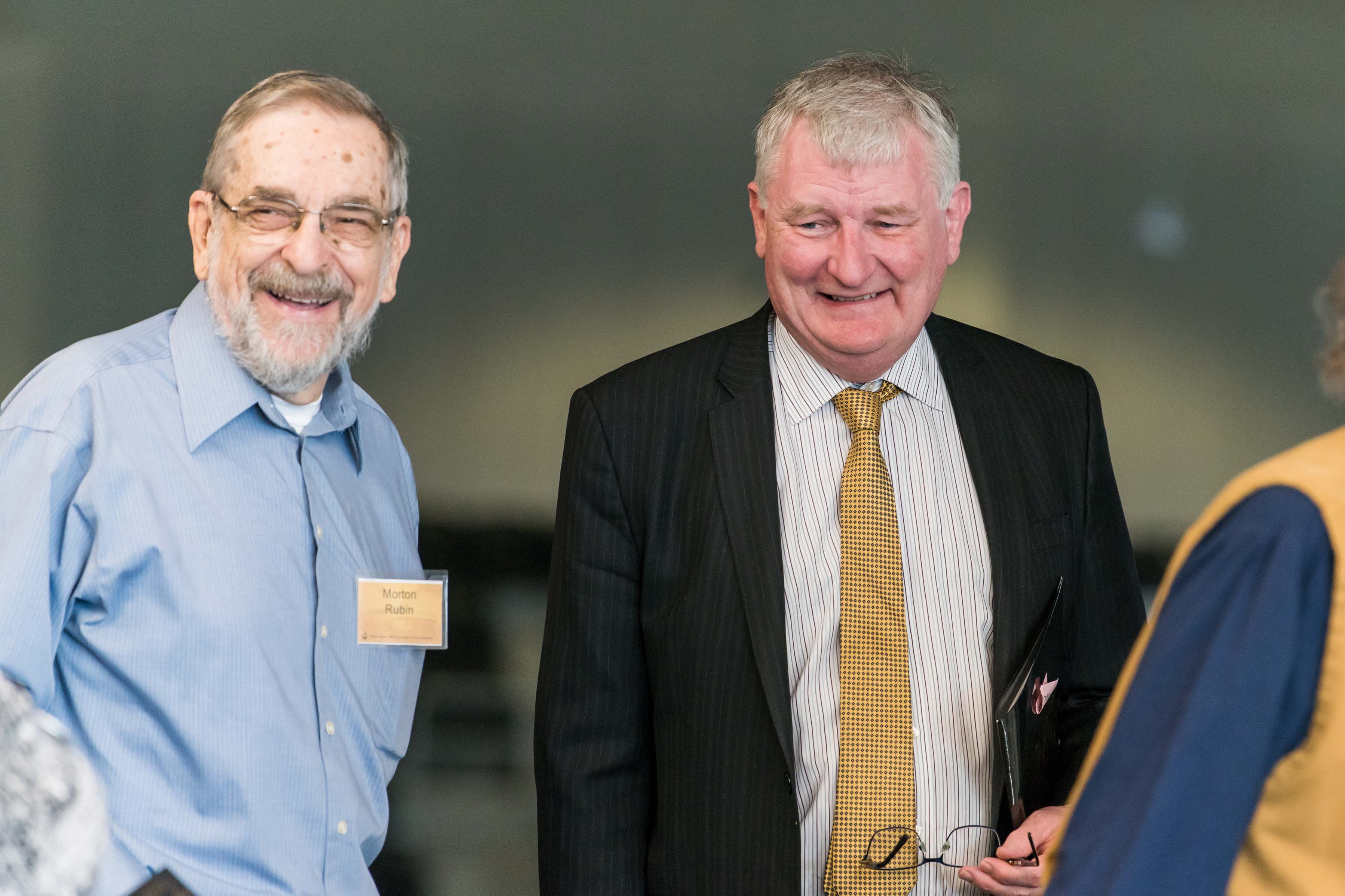 Provost Rous smiles with man at Wisdom Institute lunch