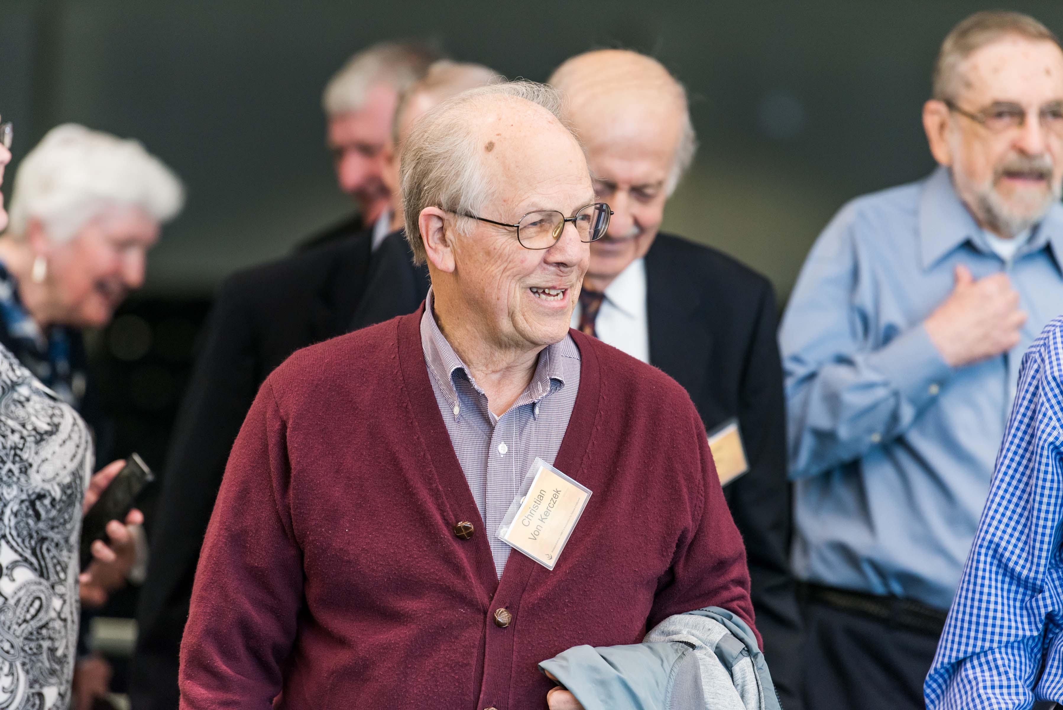 men smiling at Wisdom Institute lunch