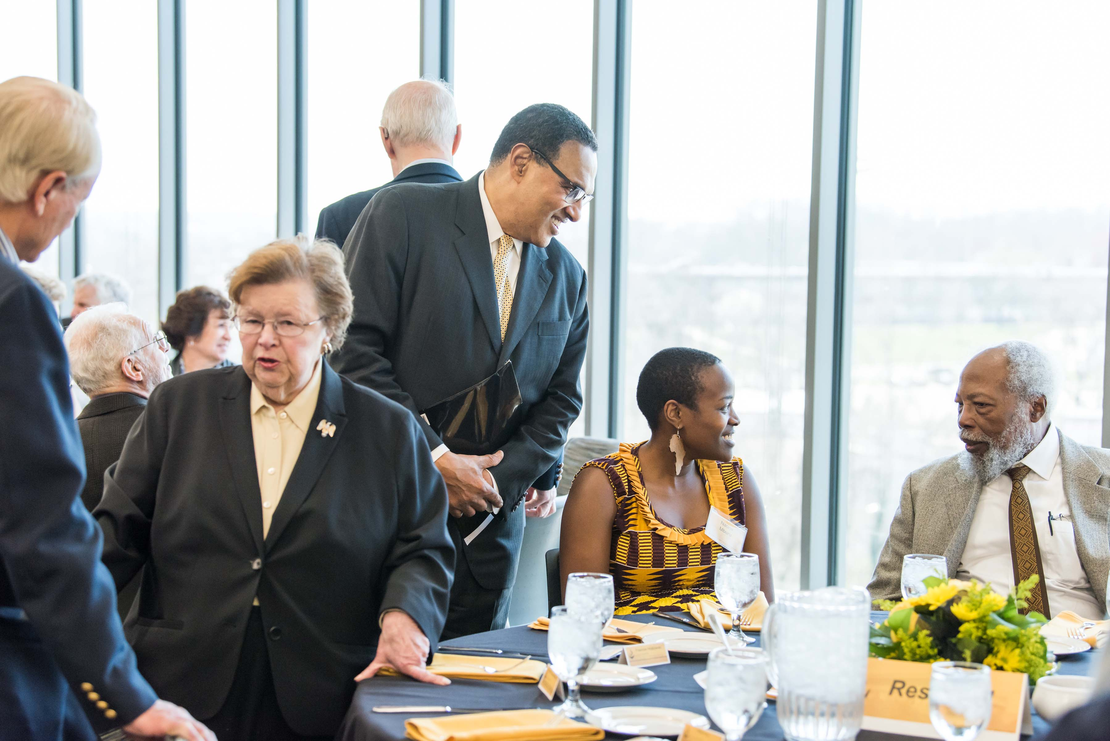 President Hrabowski joins conversation with Naomi Mburu and others at Wisdom Institute lunch