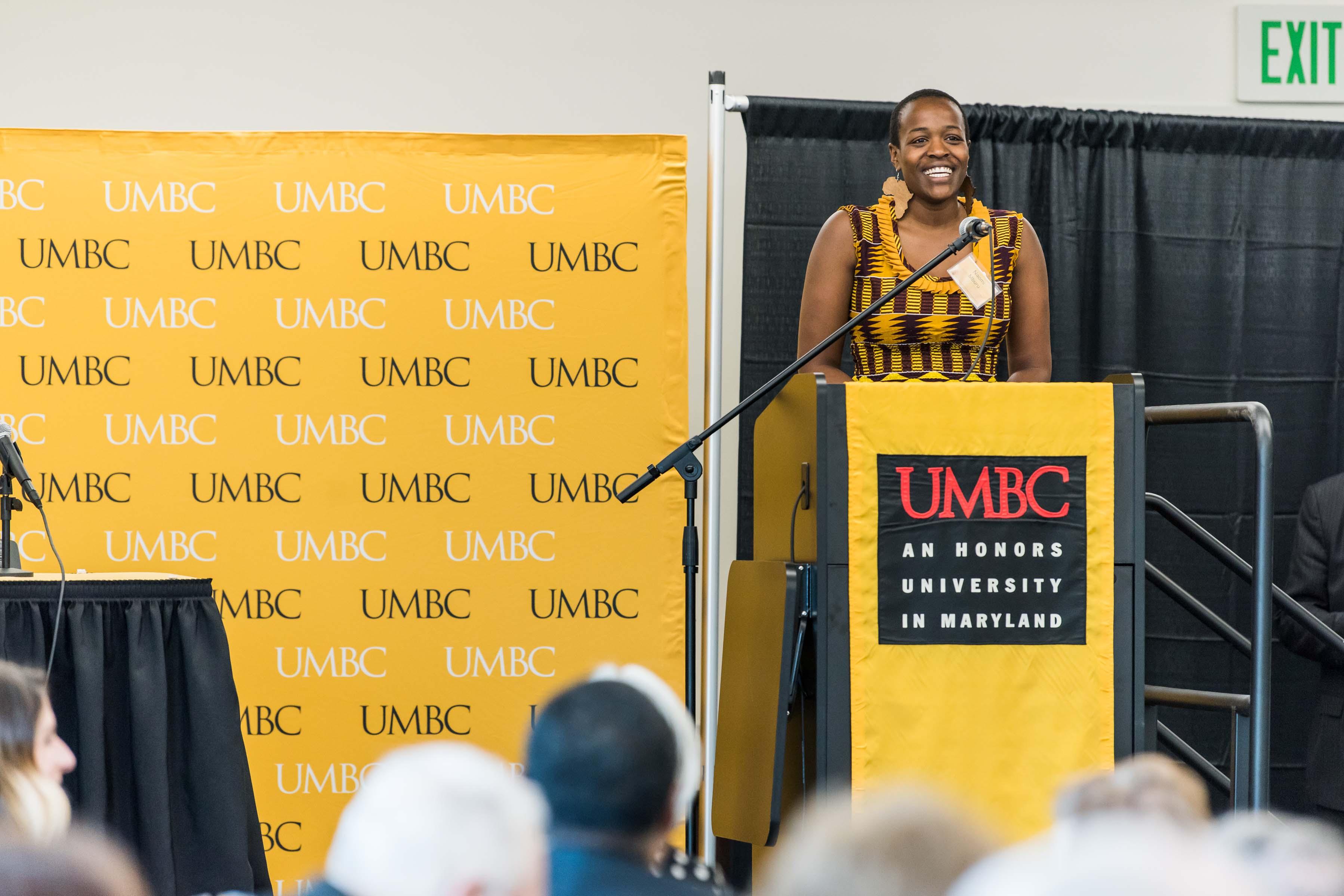 Naomi Mburu gives speech at Wisdom Institute lunch