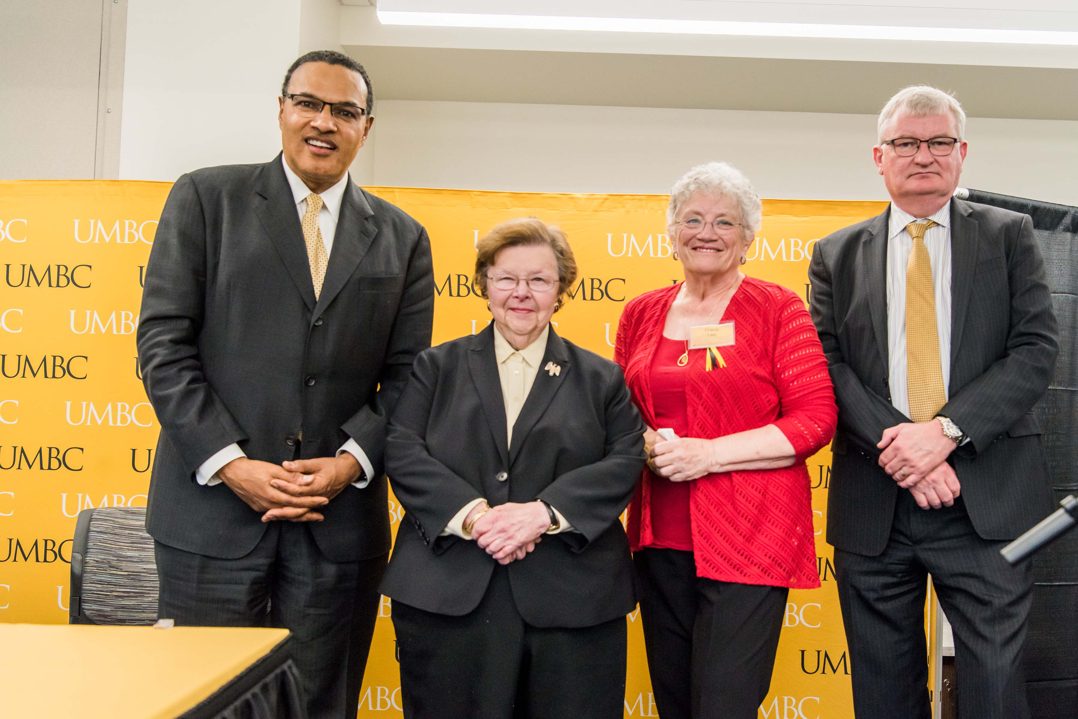 Group of campus leaders including Hrabowski pose together at Wisdom Institute lunch