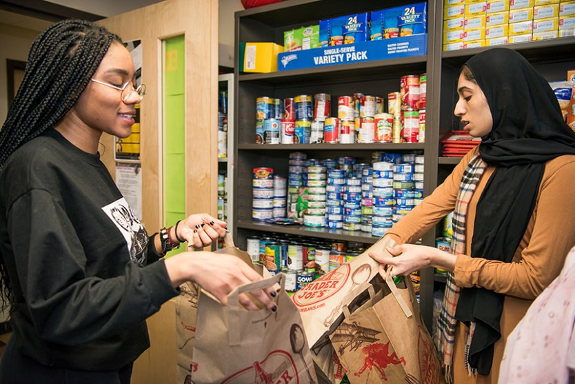 Students work in the Retriever Essentials food pantry on campus.