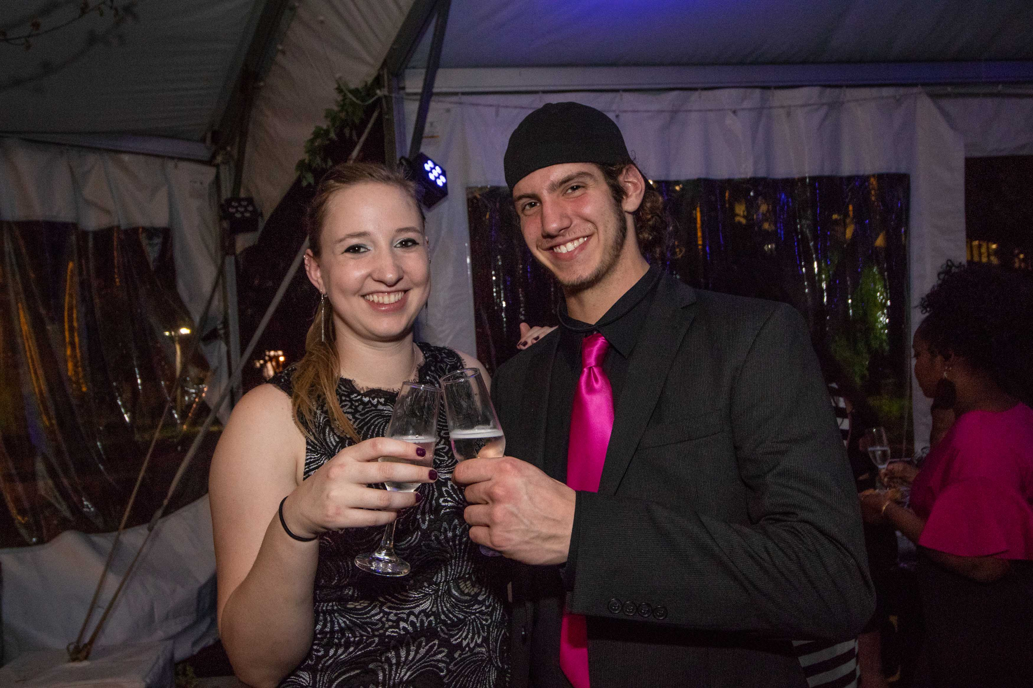 Man and woman clink glasses together