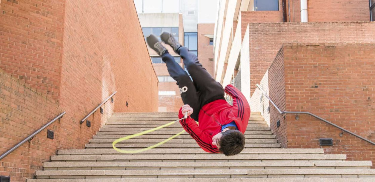 Devin flips with jumprope down UMBC steps