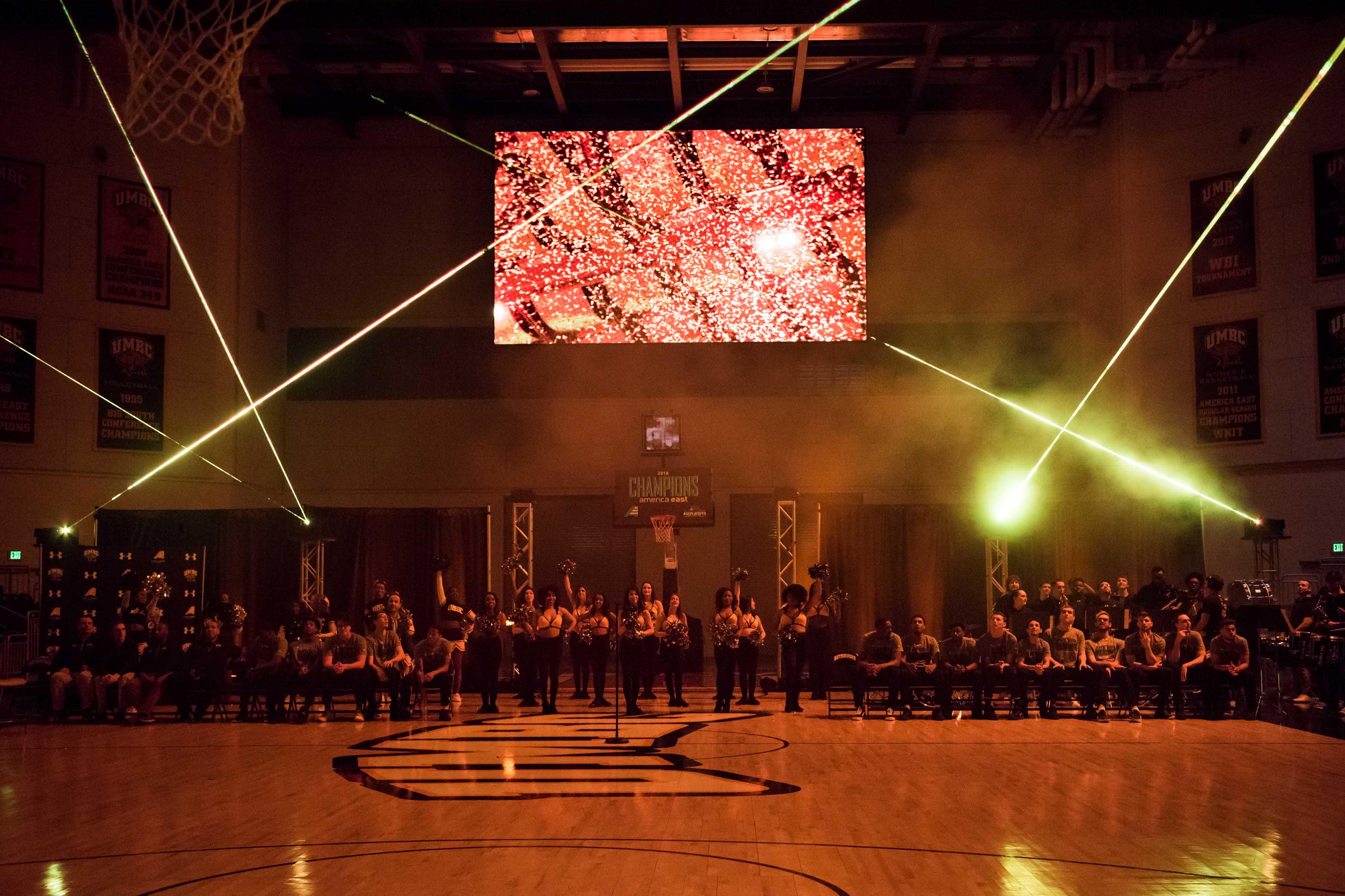 lasers and smoke at men's basketball celebration