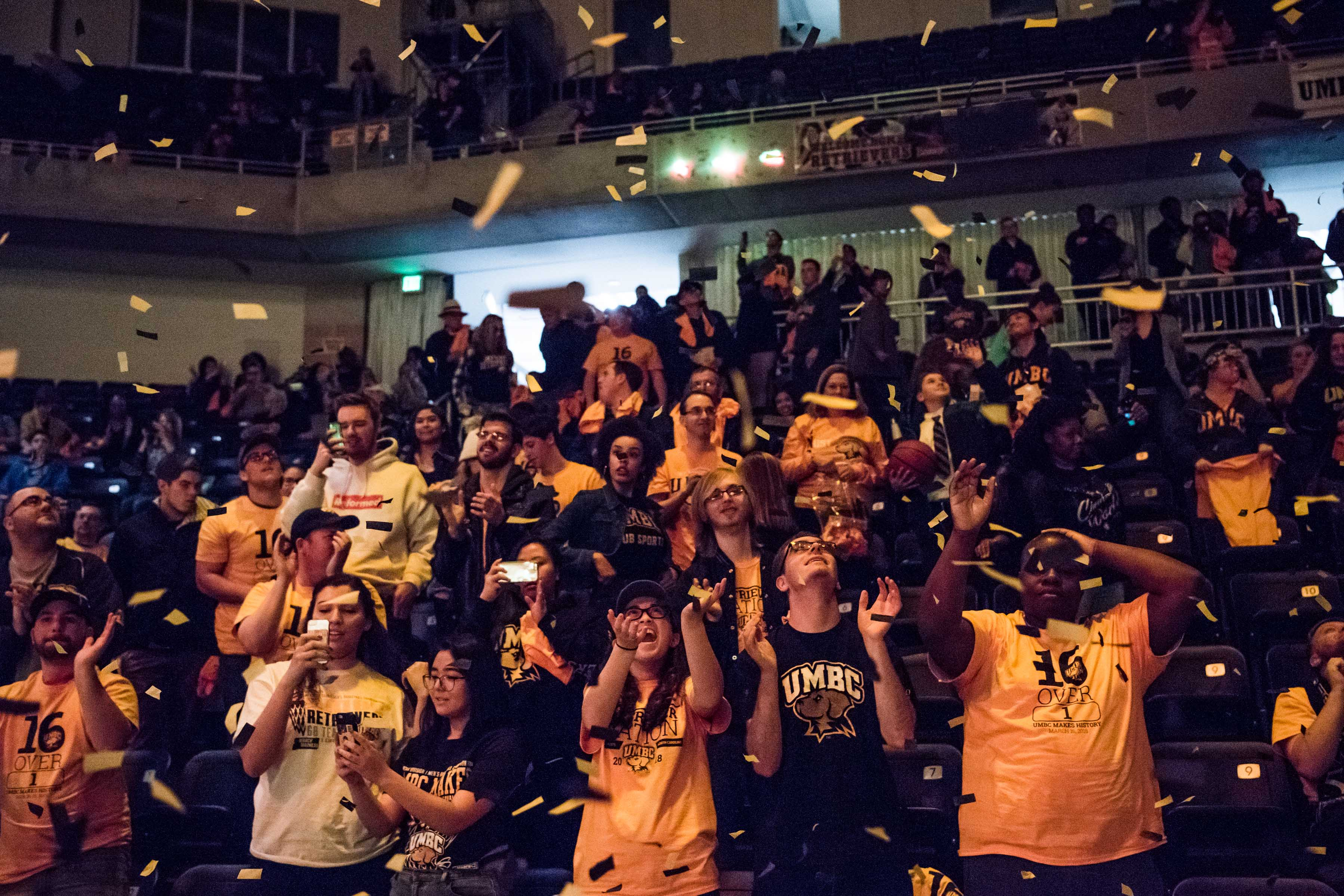 Confetti falls onto crowd at basketball celebration