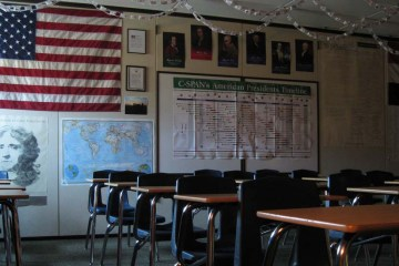 Empty Classroom with American flag and presidents on the wall