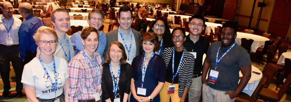Group of students and staff pose at CLDE conference