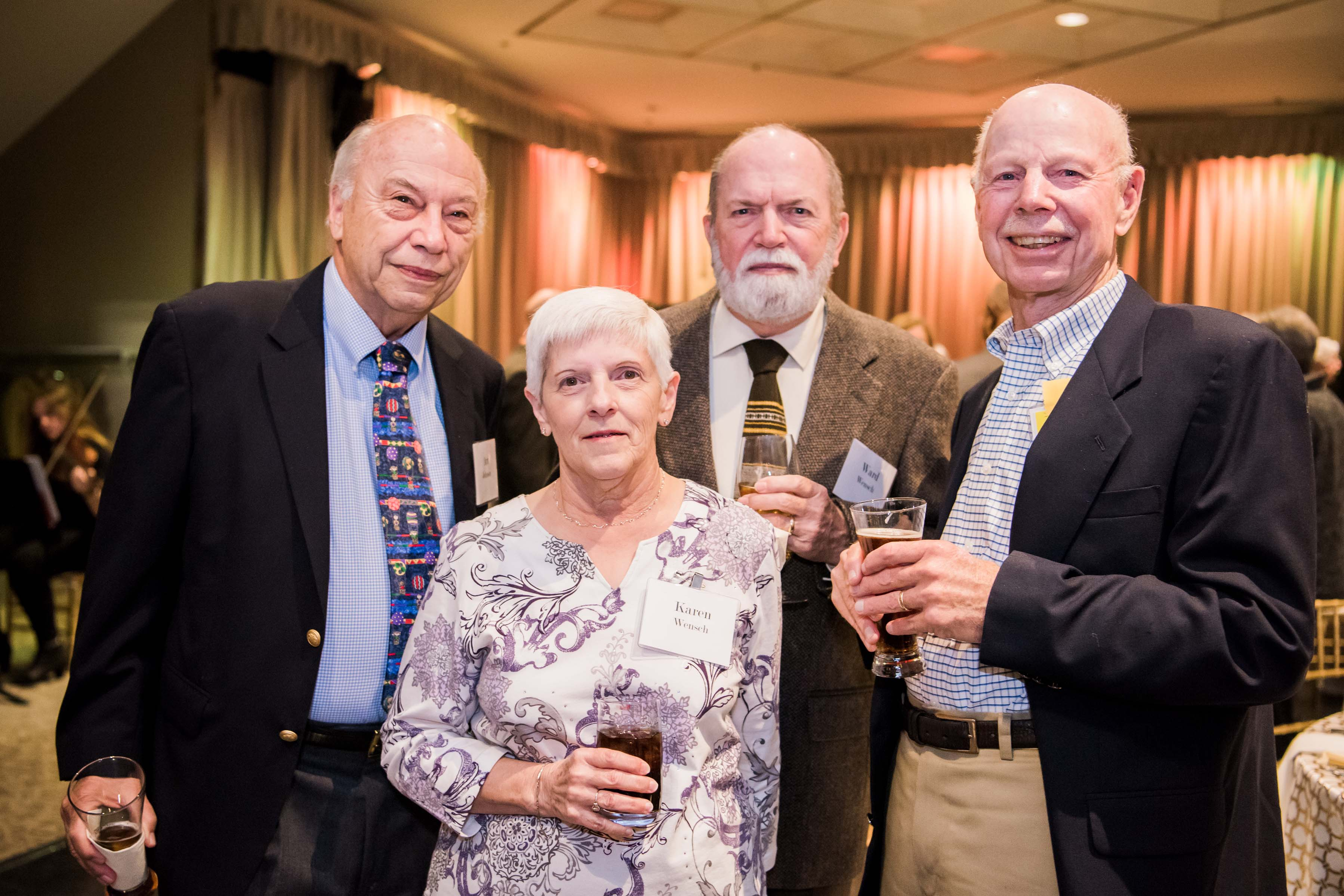 Group of older individuals pose with their drinks