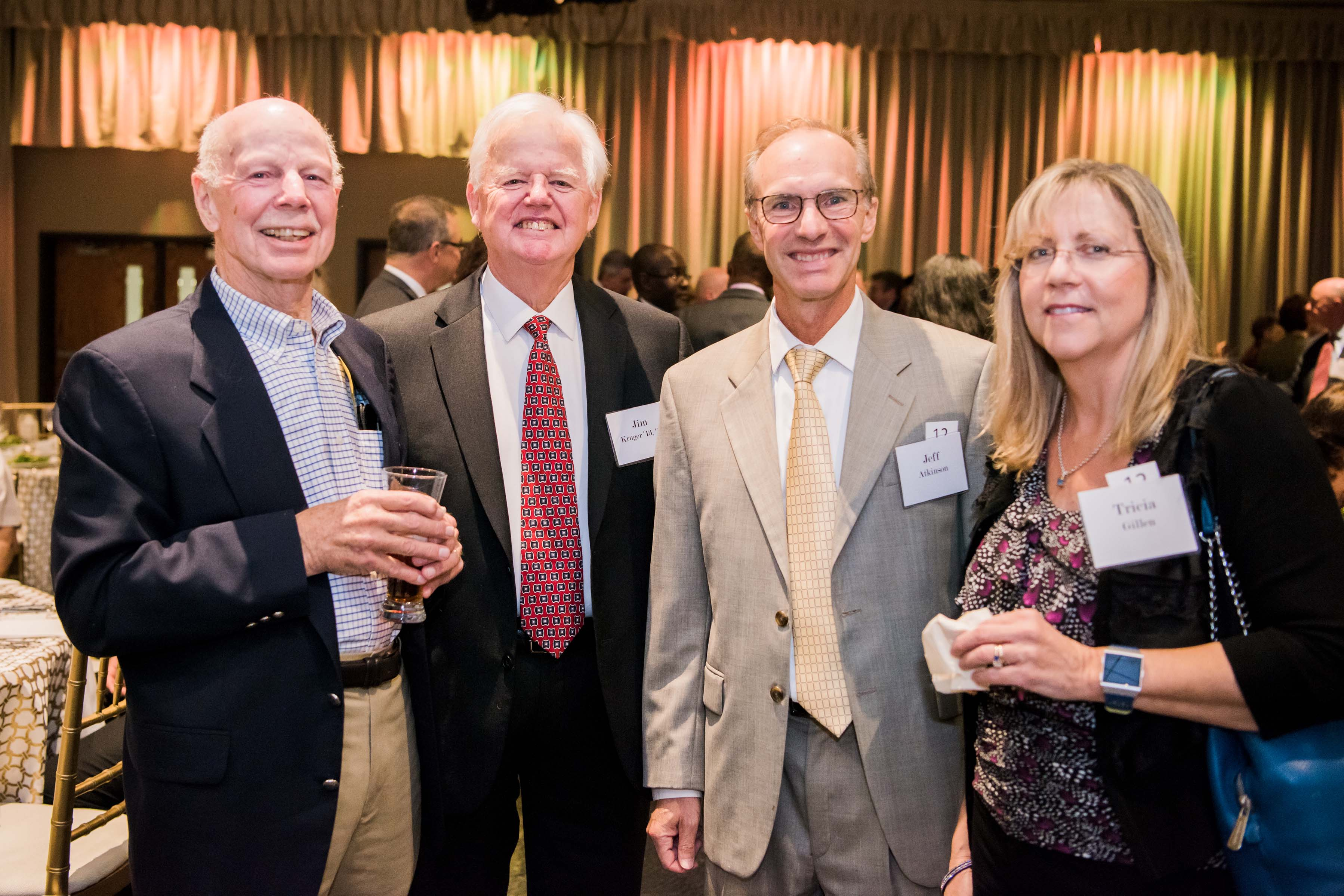 Ed, Jim, Jeff and Tricia pose together at Celebration dinner